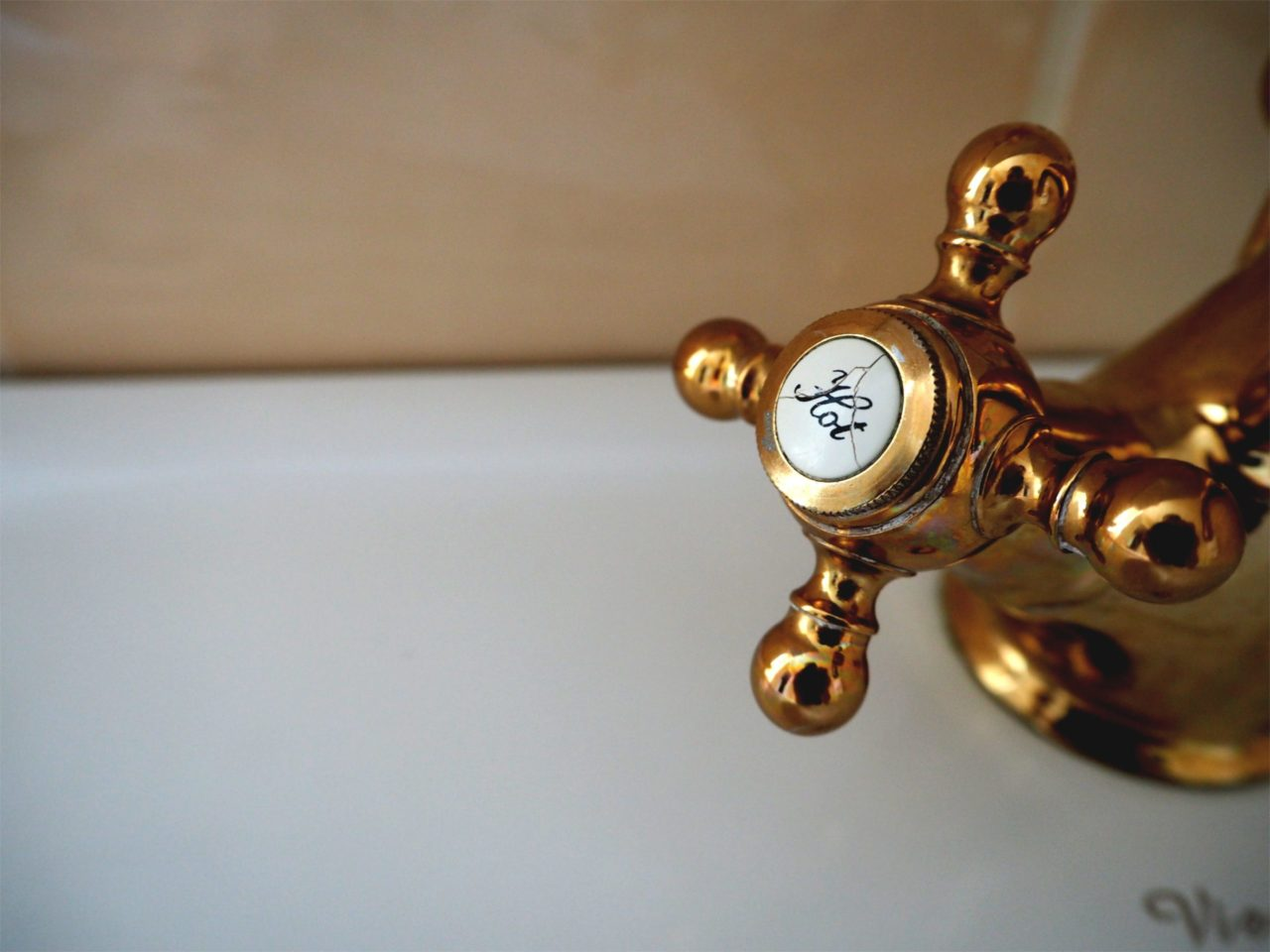 Delayed hot water faucet